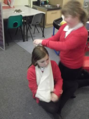 First we placed the triangular bandage....