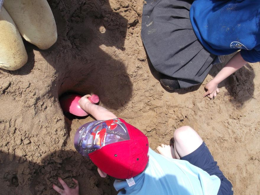 We loved digging holes in the sand!