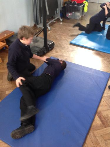 Shay putting Conner in the recovery position.