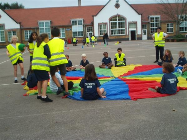 teaching the infants parachute games