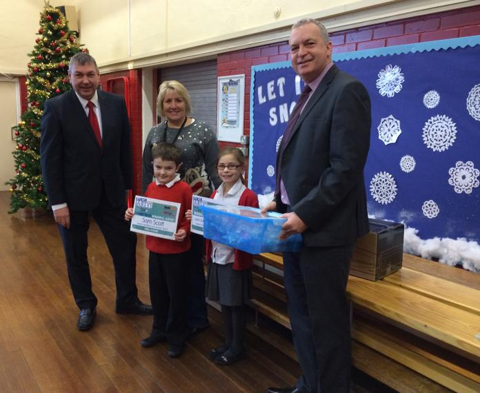 Sam & Leah presented with prizes by Charlie from Education Express and Richard from Fellowes with Mrs Piotrowicz