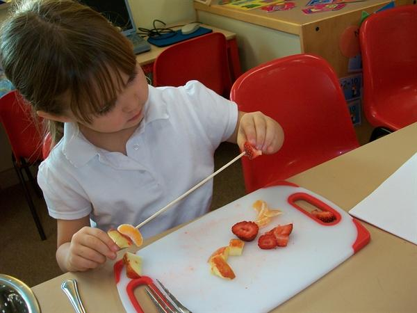 Then we pushed the fruit pieces onto kebab sticks.