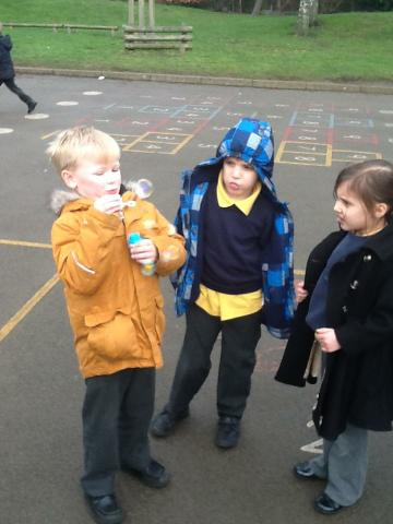 Giving instructions on how to blow a bubble!
