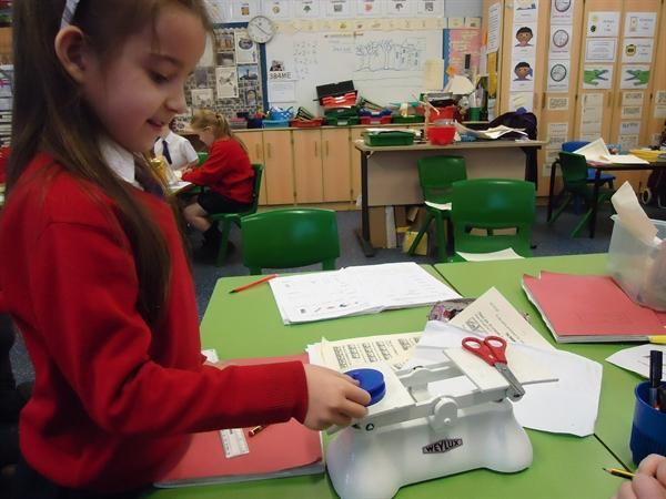 Maths-Using weights to measure mass.