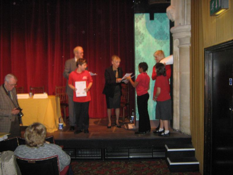 Certificates being presented by the President of the Rotary Club of Torquay.