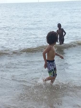 Playing in the sea.