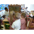 The children looked carefully at the bee hive