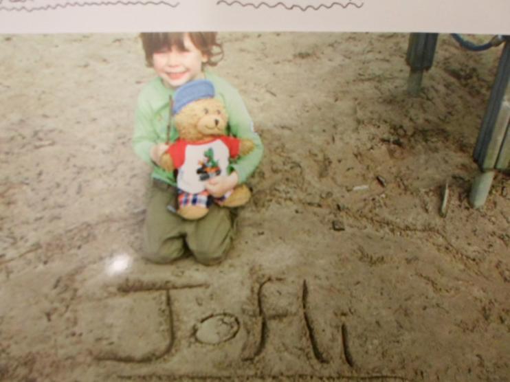 Jofli enjoying himself in the sand.
