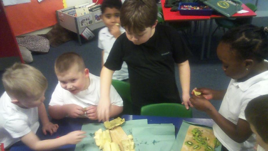 We tried pineapple and kiwi fruit today!