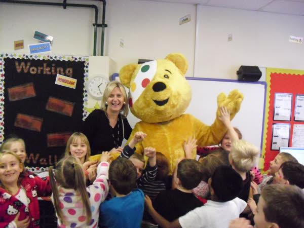 Mrs Taylor welcomes Pudsey Bear to our school!