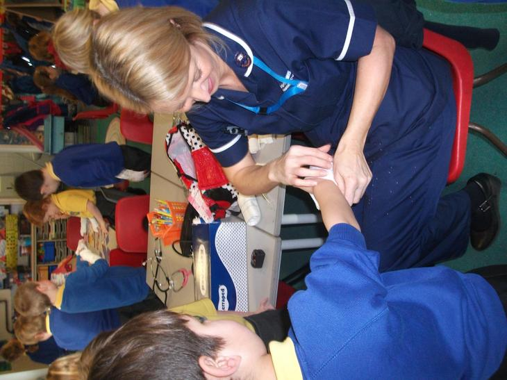 Jane showed the children how she bandaged arms.