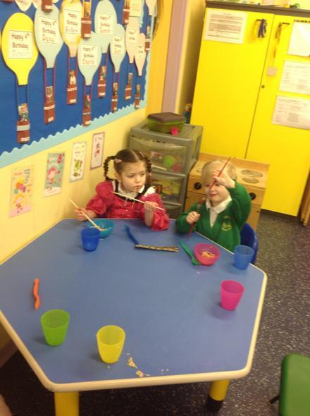 Ember & Emily using the chopsticks!