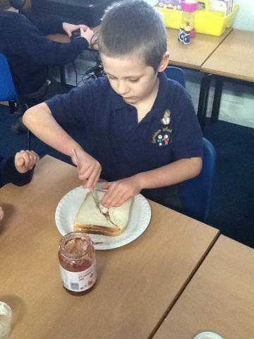 making jam sandwiches