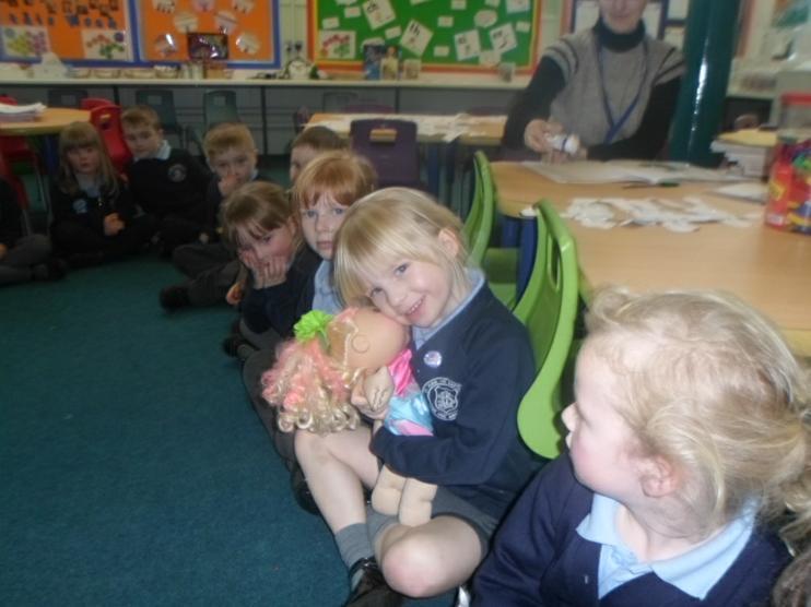 The children giving Eden a cuddle.