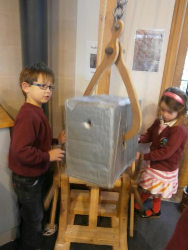 Using a winch to lift the heavy stones