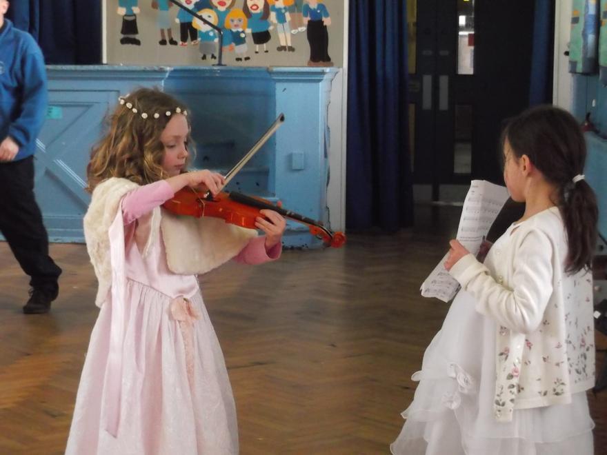 Hannah on the violin, the wedding entertainment.