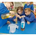 Teamwork when making potions (science/maths)!