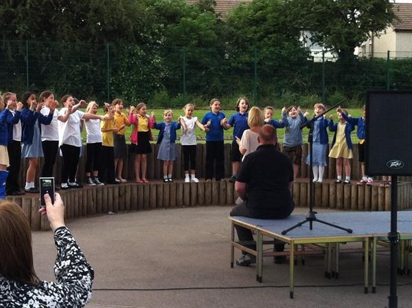 "The school choir performing ""My God"""