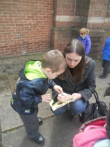 Luke and his Mum looked for minibeasts.