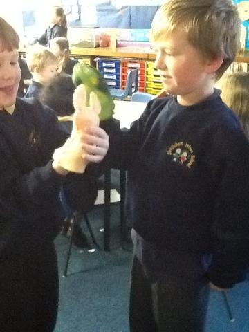 Acting out the story with hand puppets