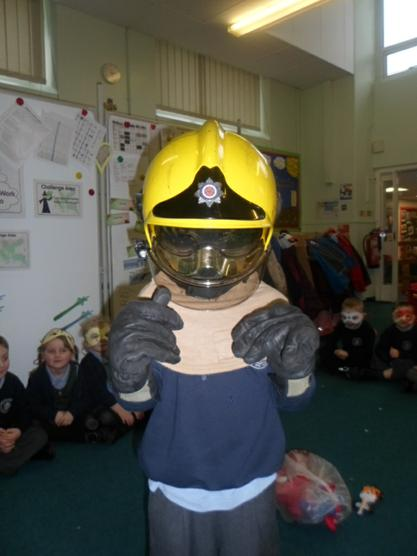 A real Firefighters helmet and gloves.