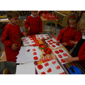Finger painting poppies for Remeberance day.