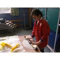 Rolling a felt bag handle