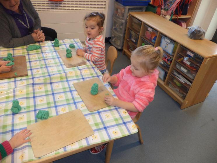 Building snowmen using play dough ( fine motor)