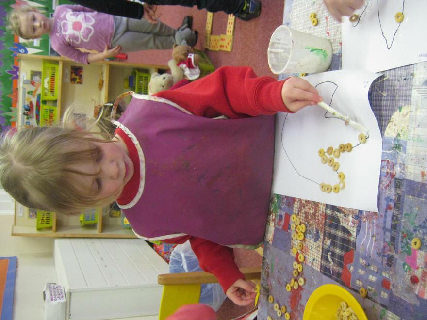 We used cherios to make a dinosaur footprint.