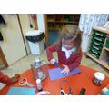 Ferne making a lantern.