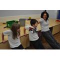 Mrs Chambers demonstrating tricep dip warm-ups