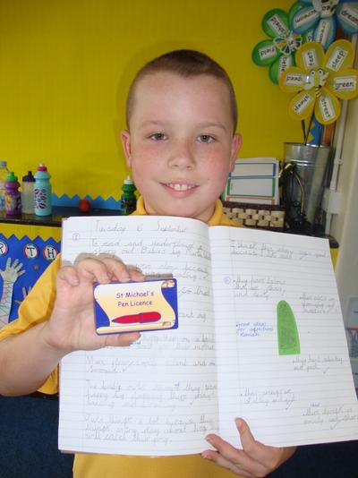 How proud are we of this young man. Look at his wonderful cursive writing.