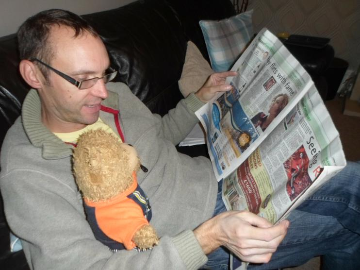 Jofli reading the paper with Mr Collins.