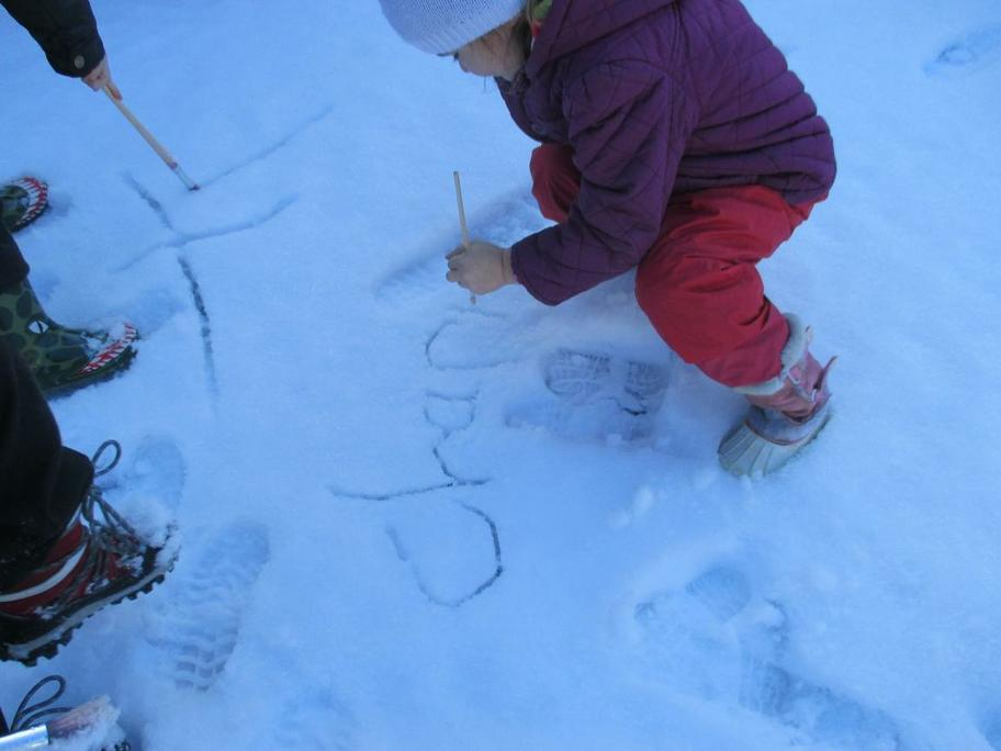 Writing in the snow using paintbrushes