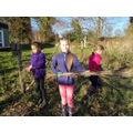 All the girls busy tidying the meadow area